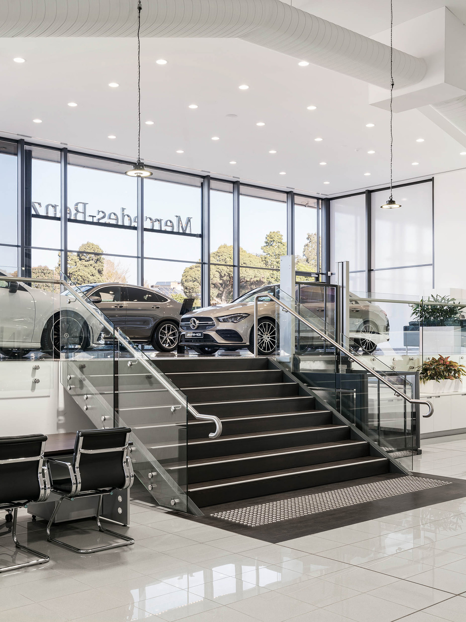 c. kairouz architects commercial interior design for car dealership showroom fitout stairs image
