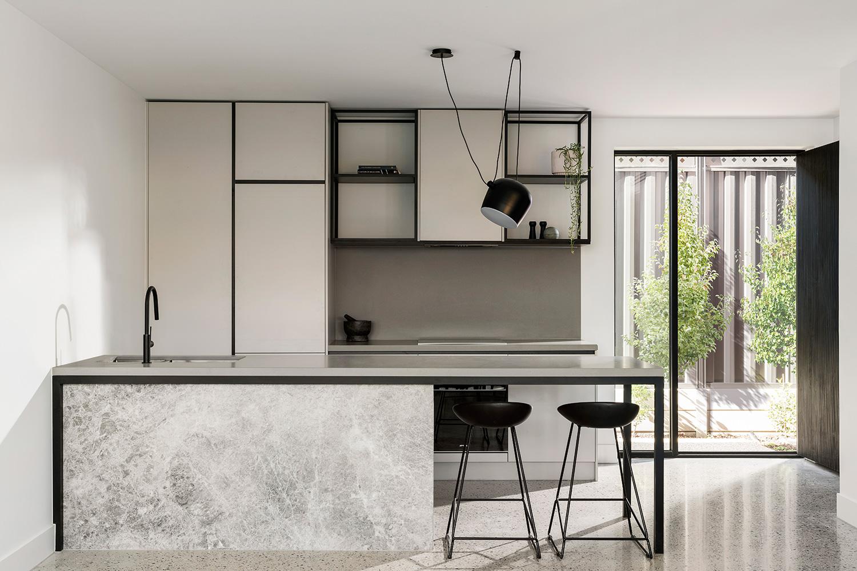 black grey kitchen design with island bench by c. kairouz architects